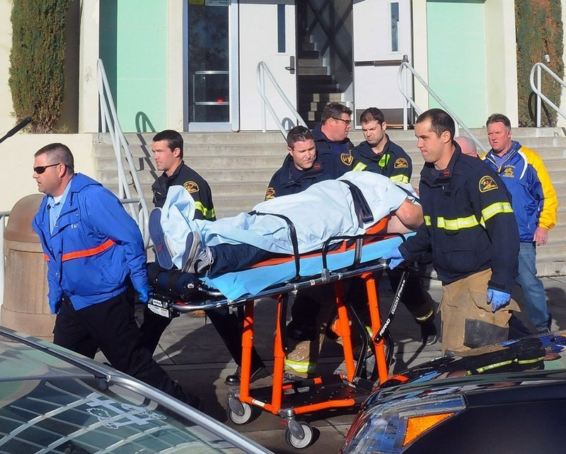 Paramedics transport a student wounded during a shooting Thursday at a high school in Taft, Calif. Police said a student was shot and another student was taken into custody.