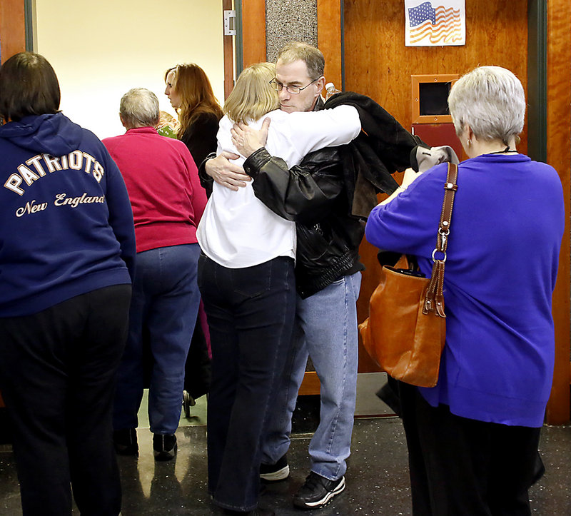 Mark Gerber, Renee Sandora's step-father, hugs Wanda Estes, Sandora's aunt, after Joel Hayden was found guilty of killing Sandora, the mother of his four children, and his longtime friend Trevor Mills in the Cumberland County Courthouse in Portland on Monday afternoon January 14, 2013.