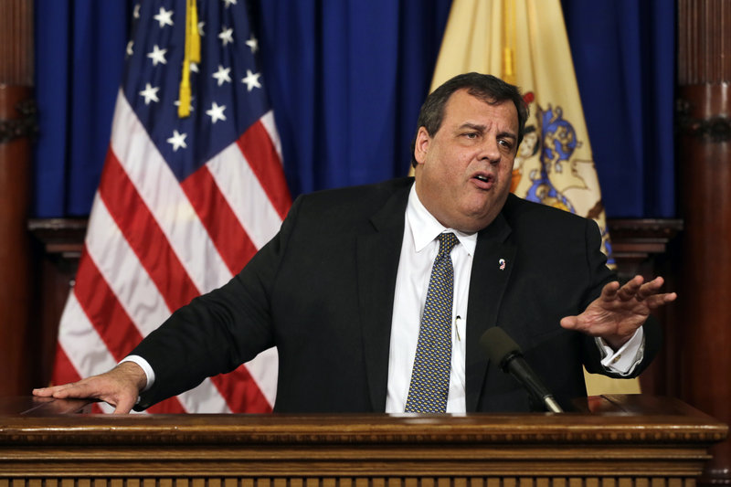"New Jersey Gov. Chris Christie answers a question Thursday at a news conference where he called an NRA ad focusing on President Obama's daughters ""reprehensible."""