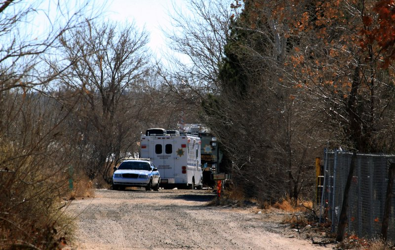 Bernalillo County authorities are stationed outside a home south of Albuquerque, N.M., on Sunday, where two adults and three children were found shot to death.