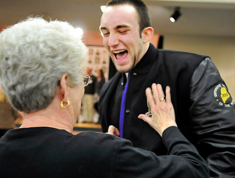 Kurt Massey, of John Bapst High School, is congratulated by his grandmother, Pat Massey, after being named Gaziano Defensive Lineman. Massey led the Little Ten in sacks.