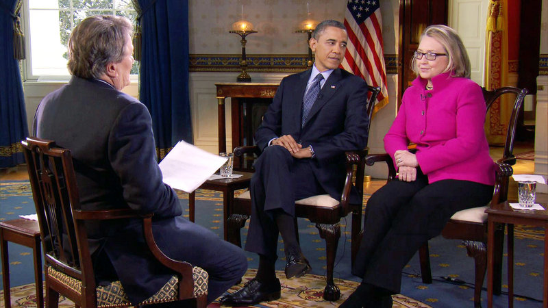 """President Obama and Secretary of State Hillary Rodham Clinton speak with """"60 Minutes"""" correspondent Steve Kroft, left, Friday in the Blue Room of the White House in Washington in this image taken from video and provided by CBS."""