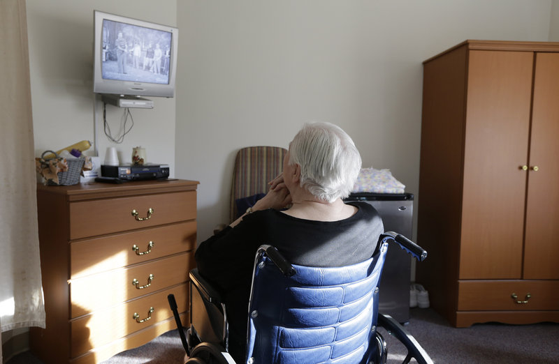 "An elderly woman watches ""I Love Lucy"" on a television inside her room at Cedar Village retirement community in Mason, Ohio. The Shalom Center, which is a part of the community, offers shelter, along with medical, psychological and legal help, to elderly abuse victims in this northern Cincinnati suburb. The center asked that this woman's identity be protected for this story because the close relatives who allegedly abused her don't know where she is."
