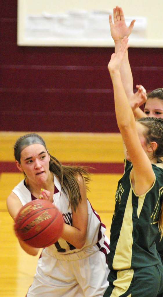 DISH IT OFF: Richmond's Jamie Plummer, left, looks to pass around Rangeley defender Abby Abbott during the Bobcats' 50-37 win Tuesday in Richmond.