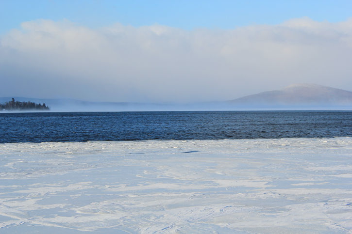 A Maine Warden Service photo of Rangeley Lake, where the search for three missing snowmobilers was suspended Tuesday due to bad weather.