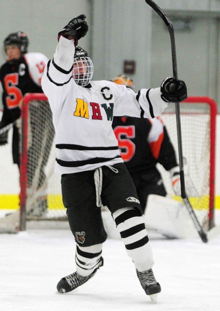 GOAALLLL: MHW junior forward Dan Condon celebrates scoring the Hawks' first goal during the Hawks' 4-1 win Saturday in Kents Hill.