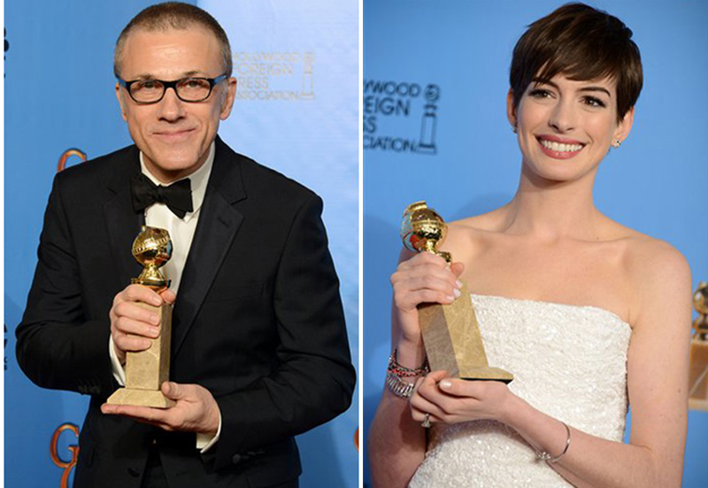 "Christoph Waltz and Anne Hathaway pose with their awards backstage at the 70th Annual Golden Globe Awards on Sunday. Waltz won for best performance by an actor in a supporting role in a motion picture for ""Django Unchained."" Hathaway won for best performance by an actress in a supporting role in a motion picture in ""Les Miserables."""