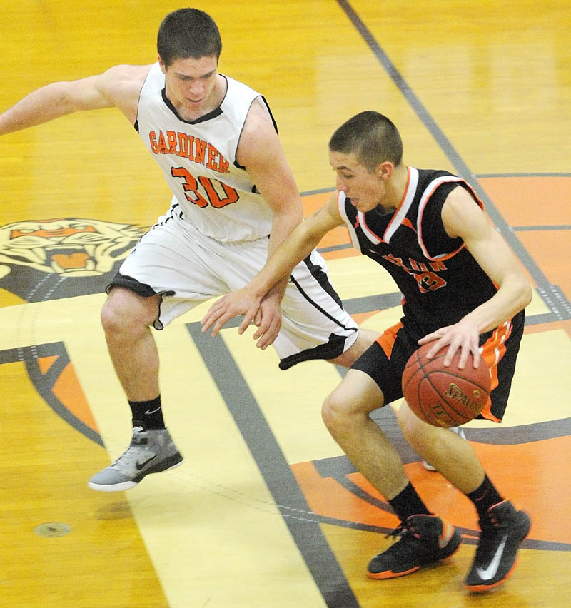 TIGHT DEFENSE: Gardiner's Dennis Meehan, left, covers Winslow's Nason Lanphier at midcourt during the Black Raiders 58-48 win Saturday at the John A. Bragoli Memorial Gym in Gardiner.