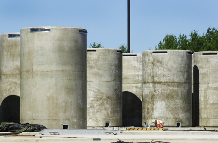 Spent fuel assemblies are stored in 64 steel-lined concrete containers like these at the dry cask storage facility at Maine Yankee in Wiscasset.