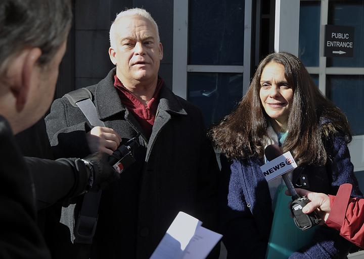 Barry and Paula Spencer talk to the press outside the Cumberland County Courthouse after their trial on charges of providing a place for underaged drinking ended in a deadlocked jury.