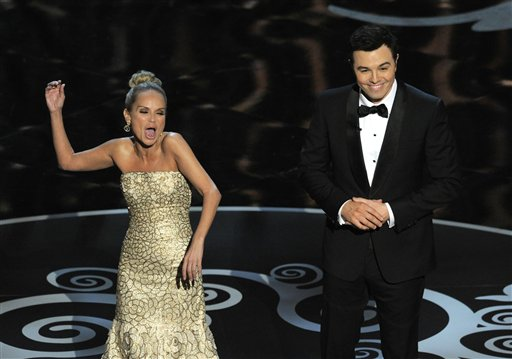 """Host Seth MacFarlane and actress Kristin Chenoweth perform a song dedicated to the """"losers"""" during the finale of the Oscars at the Dolby Theatre on Sunday in Los Angeles."""