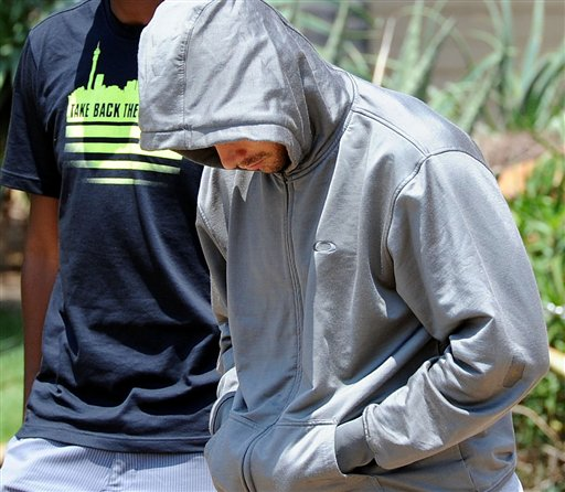 Oscar Pistorius leaves the Boschkop police station, east of Pretoria, South Africa, on Thursday, after questioning by police.