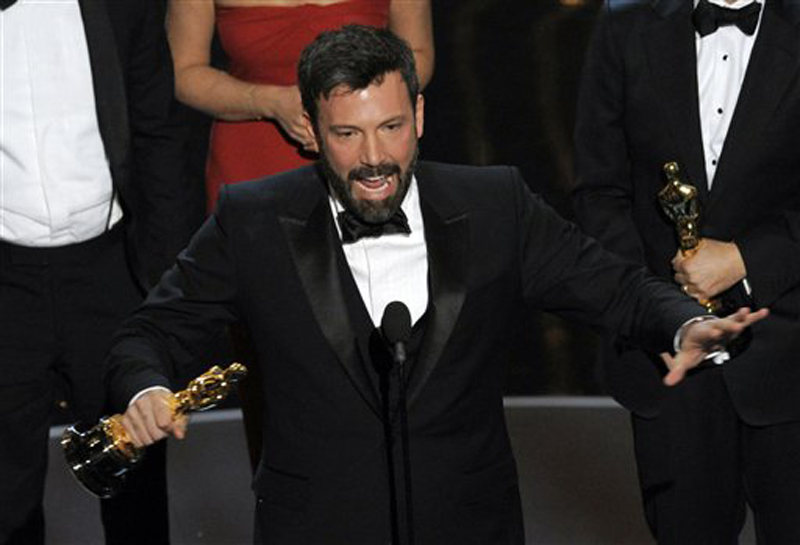 """Director/producer Ben Affleck accepts the award for best picture for """"Argo"""" during the Oscars Sunday night in Los Angeles. Oscars;Oscar"""