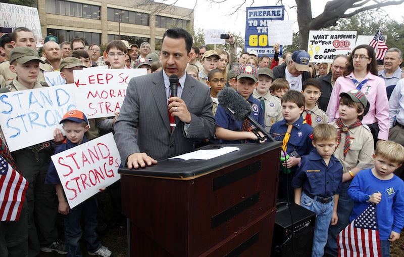 """Surrounded by area scouts, Jonathan Saenz, president of Texas Values, reads the press release to that crowd announcing that the Boy Scouts of America will be postponing its decision to admit gays at the """"Save Our Scouts"""" Prayer Vigil and Rally in front of the Boy Scouts of America National Headquarters in Irving, Texas, Wednesday, February 6, 2013. (AP Photo/Richard Rodriguez)"""