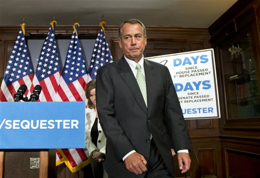"""House Speaker John Boehner, R-Ohio, wraps up a news conference on Capitol Hill on Tuesday, where he and GOP leaders challenged President Obama and the Senate to avoid the automatic spending cuts set to take effect in four days. Boehner complained that the House, with Republicans in the majority, has twice passed bills that would replace the across-the-board cuts known as the """"sequester"""" with more targeted reductions, while the Senate, controlled by the Democrats, has not acted. He is followed by Rep. Lynn Jenkins, R-Kansas is at left. (AP Photo/J. Scott Applewhite)"""