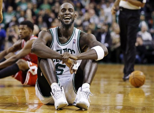 Boston Celtics forward Kevin Garnett (5) reacts on the court after a floor scramble with Chicago Bulls forward Jimmy Butler (21) during the fourth quarter of an NBA basketball game in Boston, Wednesday, Feb. 13, 2013. The Celtics gained possession of the ball and went on to win 71-69. (AP Photo/Elise Amendola)