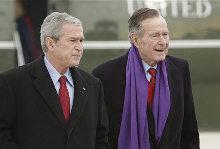 President George W. Bush walks with his father, former President George H.W. Bush in this 2008 photo. A criminal investigation is under way after a hacker apparently accessed private photos and emails sent between members of the Bush family, including both former presidents.