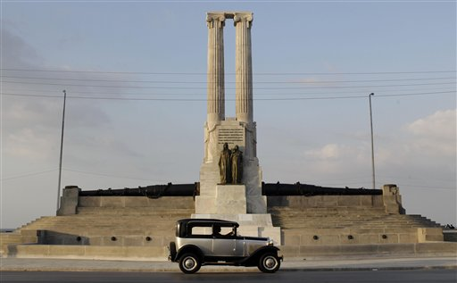 A classic car drives past the restored USS Maine monument in Havana, Cuba, on Tuesday. The monument was erected in 1925 in honor of U.S. sailors who died in 1898 when the USS Maine ship sank off Havana Harbor.