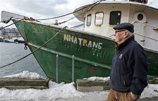 In this photo taken Wednesday, Feb. 13, 2013, Ron Gilson, a 79-year-old life Gloucester native, walks along the fish pier in Gloucester, Mass. Fishermen from all over New England have written to Congress asking for urgent help surviving deep cuts to their catch limits. (AP Photo/Charles Krupa)