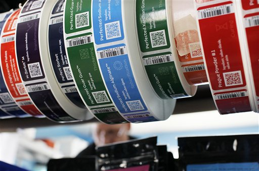 Colorful product labels frame shipper John McWilliams of Kittery at the Modernist Pantry warehouse in Eliot.