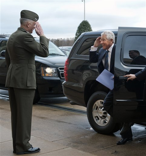 Former Sen. Chuck Hagel, R-Neb., salutes Marine Corp. Lt. Gen. Tom Waldheuser as he arrives at the Pentagon to be sworn-in as Secretary of Defense, in Arlington, Va., Wednesday. Waldheuser will be Hagel's senior military assistant.