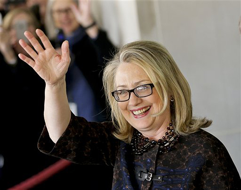 Outgoing Secretary of State Hillary Rodham Clinton waves as she leaves the State Department in Washington, Friday for last time as America's top diplomat. In four years, Clinton has traveled nearly 1 million miles to meet with leaders in more than 100 countries.