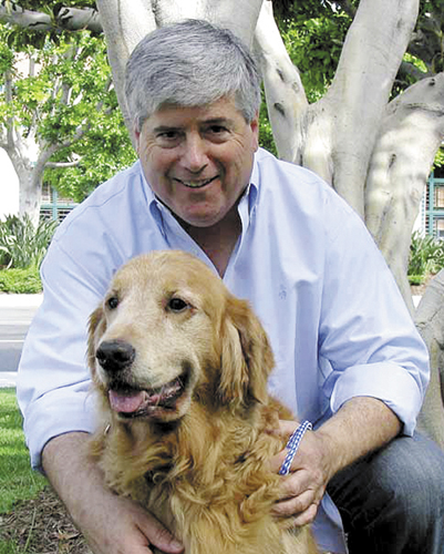 David Rosenfelt with his golden retriever.