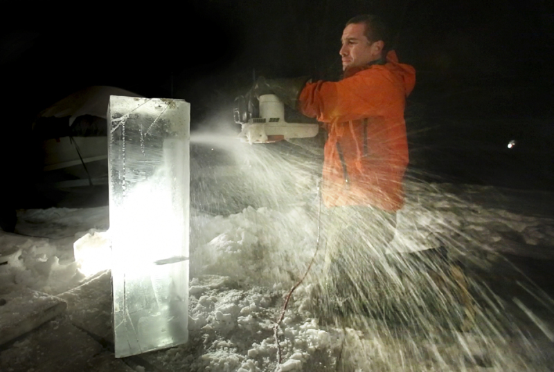 Ice sculptor Jesse Bouchard uses an electric chainsaw to cut out a detail area on a block of ice at his South Portland home on Tuesday. The blocks will be constructed into an ice bar at the Hilton Garden Inn in Freeport on Friday night.