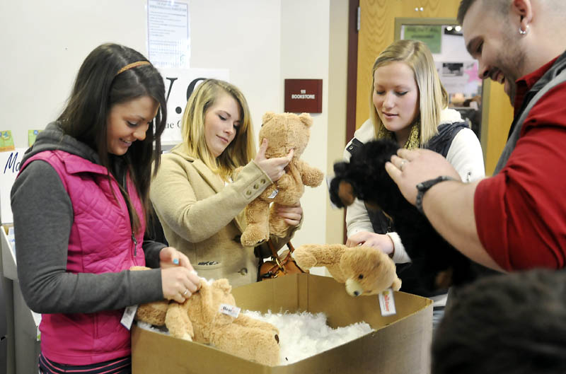 University of Maine at Augusta students stuff teddy bears Thursday at the student center as part of a Valentine's Day celebration. The White House has launched the College Scorecard, an online tool to review the expenses and graduation rates of colleges across the nation, including UMA.