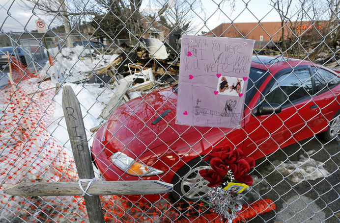 A memorial on a fence at the site of a propane gas explosion on Bluff Road that claimed the life of 64-year-old Dale Ann Fussel.