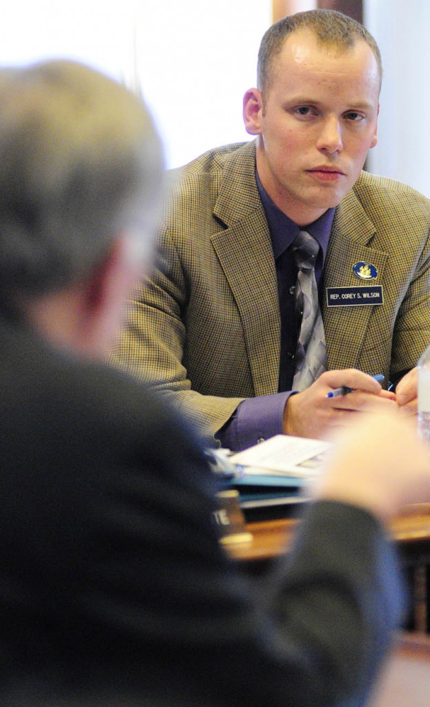 Rep. Corey Wilson, right, listens as corrections Commissioner Joseph Ponte answers his questions about plans to close the Central Maine Pre-Release Center in Hallowell ,during a meeting of the Legislature's Criminal Justice and Public Safety committee on Monday, on the fourth floor of the State House in Augusta.
