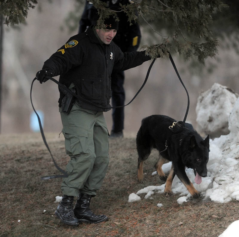 A Kennebec County Sheriff K-9 unit searches the area around Key Bank on Kennedy Memorial Drive Thursday after a man robbed the place and made off with an undisclosed amount of money.