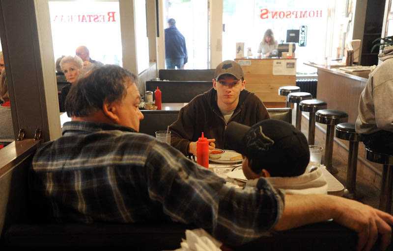 Parker Stevens, left, sits with his two sons, Seth, 19, center, and Brady, 12, during lunch at Thompson's restaurant on Main Street in Bingham on Wednesday. Parker was the owner of the restaurant, before selling to Jay Strickland recently.
