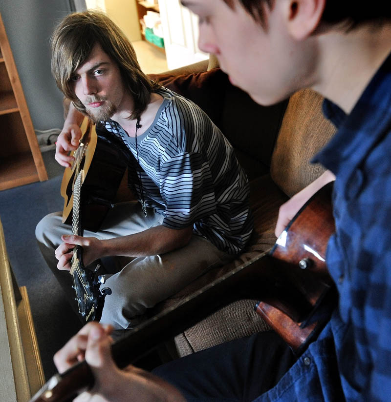 Alex West, 17, left, jams with his friend, Tim Thompson, 16, at their residence hall cottage on the Good Will-Hinckley campus in Hinckley on Wednesday. Gov. LePage spoke about West during his State of the State address in Augusta Tuesday night.