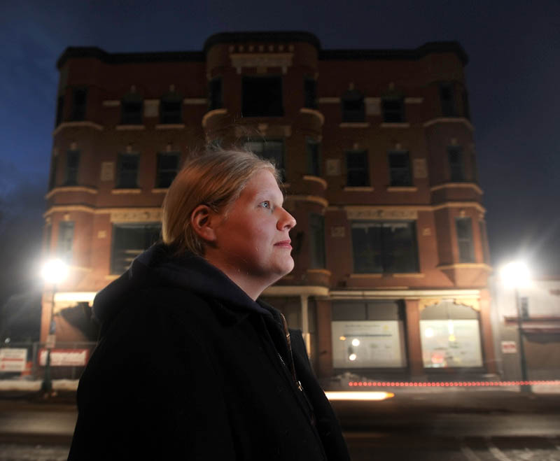 Kerri Marion, 28, of Fairfield, has been photographing the renovations of the Gerlad Hotel on Main Street in Fairfield, seen in the background.