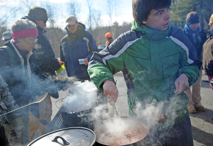 "Cody Curtis, 16, of Skowhegan, stirs a batch of his ""dulce a pico"" chili at the annual chili cookoff, at the Winter Festival at Lake George on the Skowhegan and Canaan town line, on Saturday."