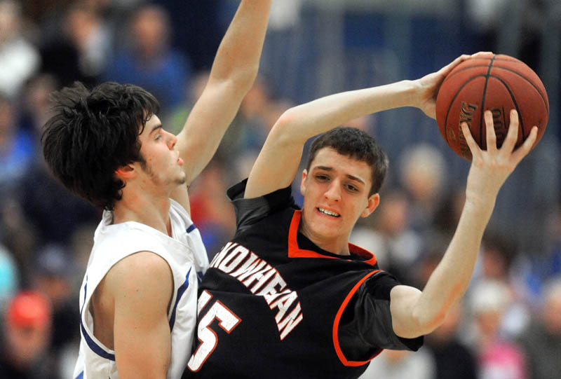 PRESSURE D: Lawrence High School's Nick Noiles, left, defends Skowhegan Area High School's Riley Teixeira in the second quarter Wednesday in Fairfield.