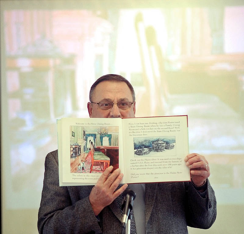 "Gov. Paul LePage reads ""Baxter at the Blaine House"" to the student body as part of the 2013 Catholic Schools Week celebration at St. John Regional Catholic School on South Garand Street in Winslow on Friday morning."