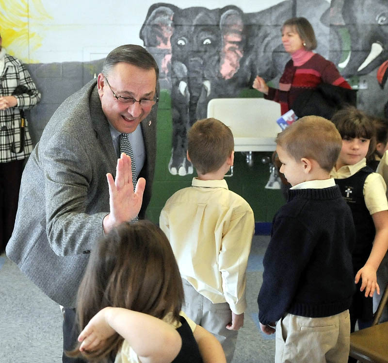 Gov. Paul LePage greets students after reading