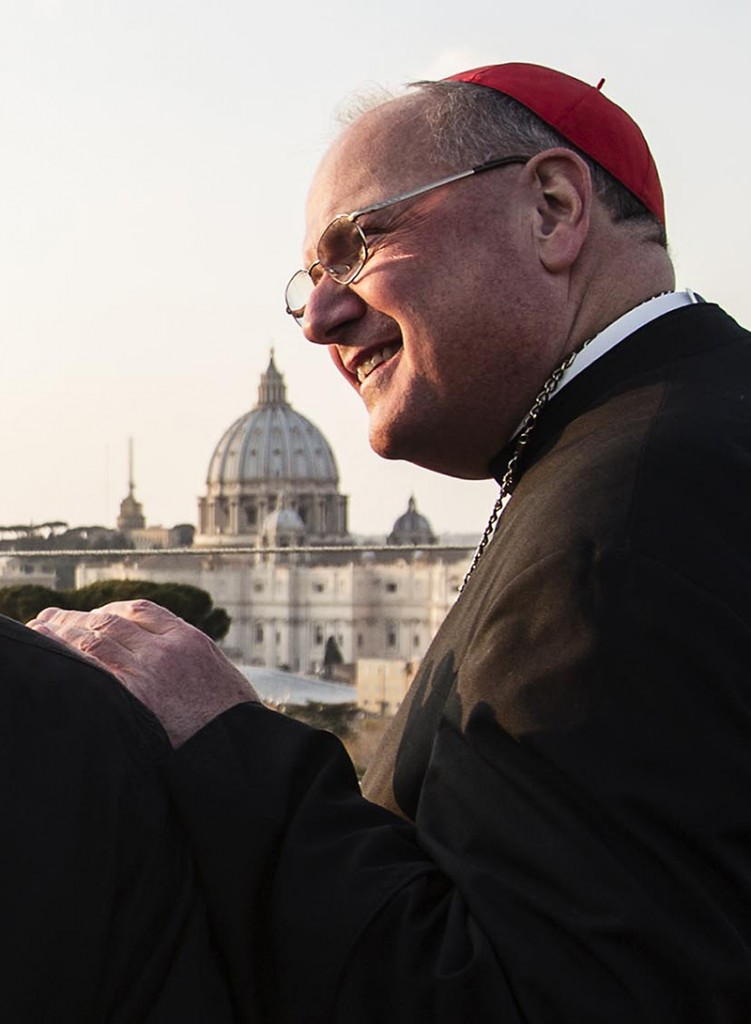 Cardinal Timothy Dolan, the Archbishop of New York, waits to see Pope Benedict XVI leave the Vatican in a helicopter taking the Pope to Castel Gandolfo Thursday.