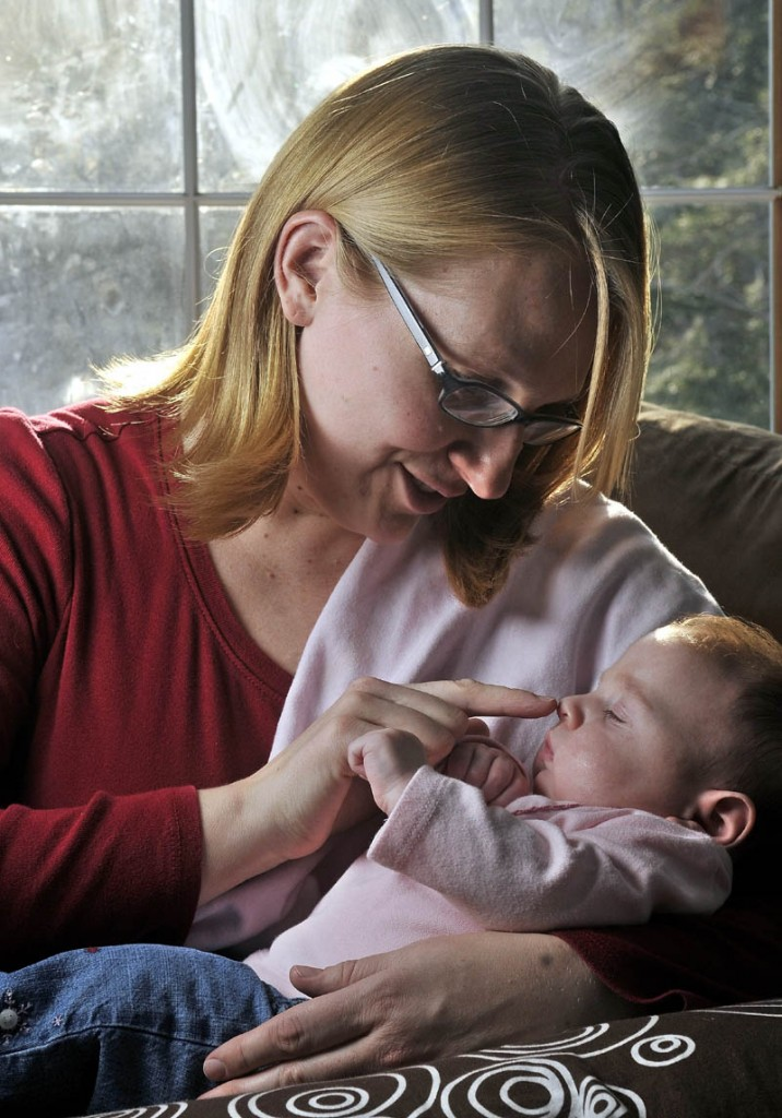 Thomasina Hutchins sits with her daughter, Eva, 3 months, at home in Winthrop on Friday.