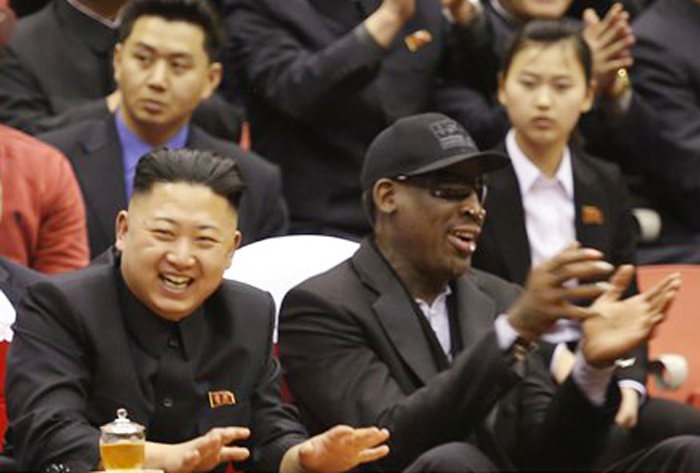 North Korean leader Kim Jong Un, left, and former NBA star Dennis Rodman watch North Korean and U.S. players in an exhibition basketball game at an arena in Pyongyang on Thursday.