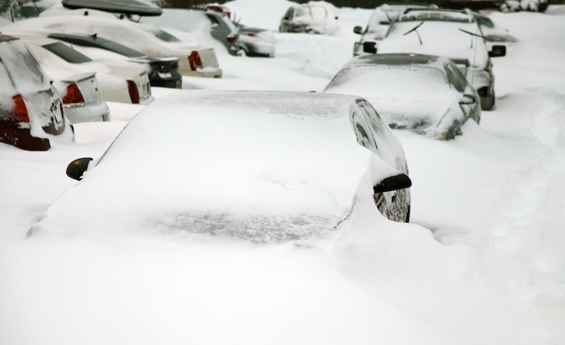 Cars sit buried by snowdrifts in a parking lot in Southington, Conn., Saturday, Feb. 9, 2013, after a heavy snowfall and high winds from a storm dumped more than 2 feet of snow on New England. (AP Photo/Robert Ray)
