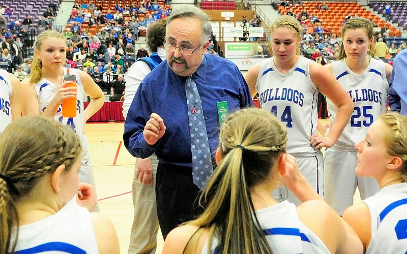 Madison coach Albert Veneziano talks to his team during a time out during a Western Maine Class C girls semifinal game against Old Orchard Beach on Thursday at the Augusta Civic Center.