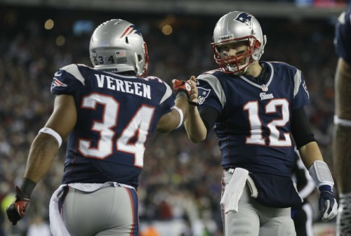 New England Patriots running back Shane Vereen, left, is congratulated by quarterback Tom Brady after Vareen's eight-yard touchdown pass reception from Brady in the AFC divisional playoff game Jan. 13. Tom Brady has signed a 3-year extension with the Patriots.