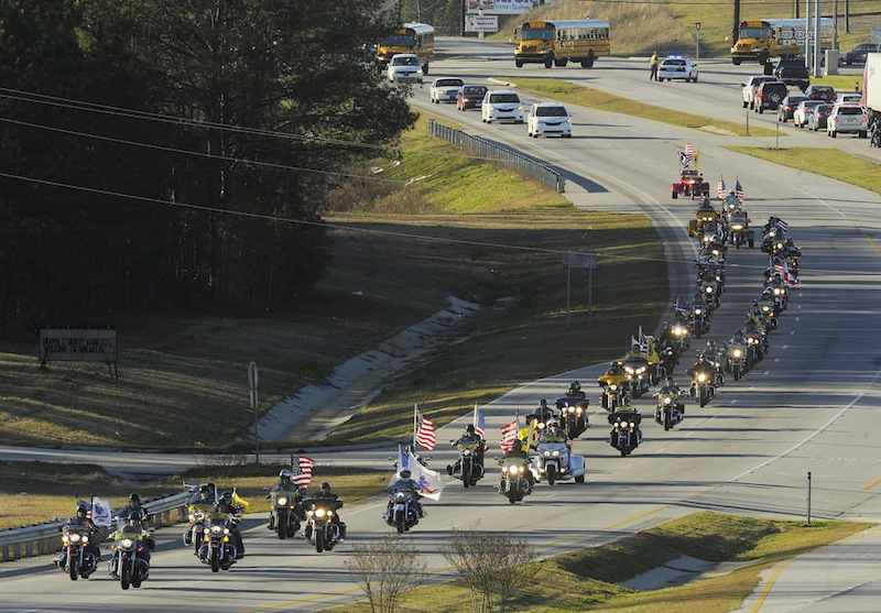 "The funeral procession of slain bus driver Charles ""Chuck"" Poland makes its way down Highway 231 in Ozark, Ala., Sunday Over 60 motorcycles and dozens of school buses join the funeral procession. The Ozark Civic Center was packed with mourners for the funeral. Burial for Poland is in Newton, Ala. (AP Photo/AL.com, Joe Songer) MIDLAND CITY HOSTAGE CRISIS 2-3-2013"