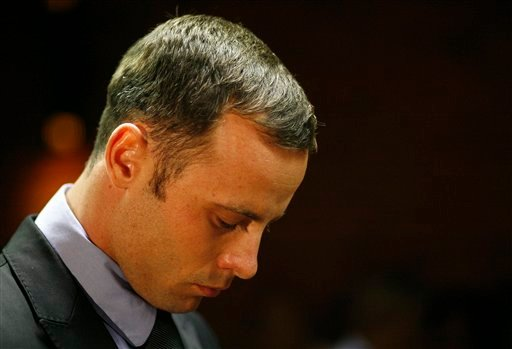 Olympic athlete Oscar Pistorius stands during his bail hearing at the magistrate court in Pretoria, South Africa on Thursday.