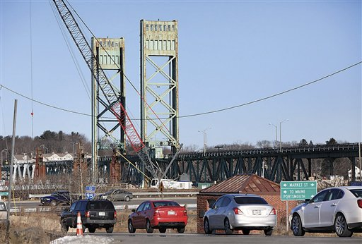 In this Jan. 23, 2013, photo, traffic backs up in Portsmouth, N.H., after the Sarah Mildred Long Bridge became stuck about a foot from its normal position.