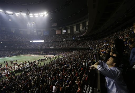 Fans and members of the Baltimore Ravens and the San Francisco 49ers wait for power to return in the Superdome during an outage in the second half of the NFL Super Bowl XLVII football game on Sunday.