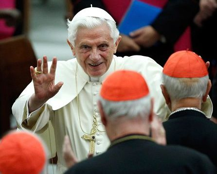 In this Nov. 26, 2011, photo, Pope Benedict XVI leaves Paul VI hall after attending a concert at the Vatican.